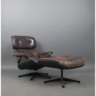 Broken Arm on Eames Lounge Chair
