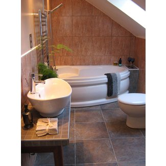 Corner Bath Tubs Are Big in Small Spaces