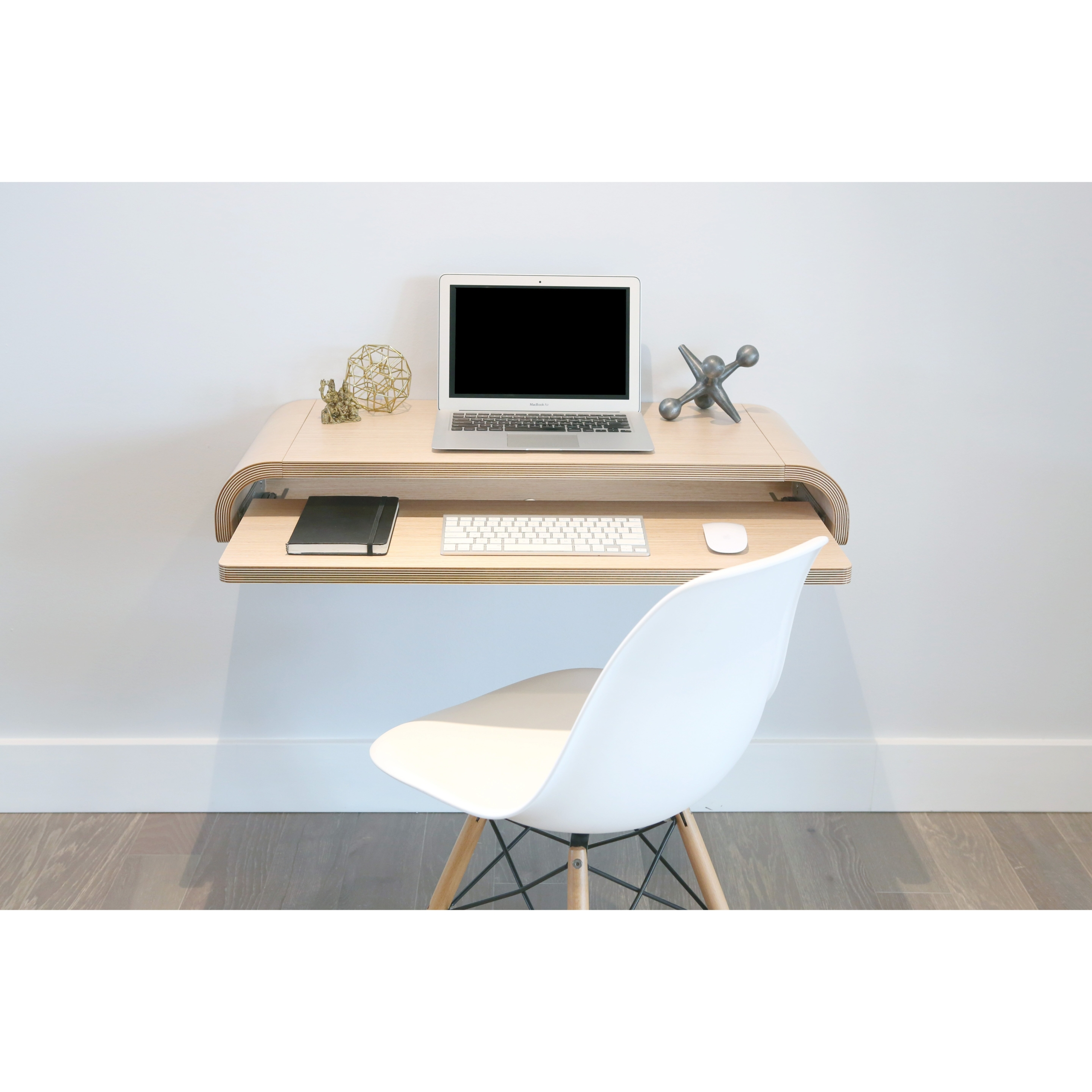 minimal floating desk with curved end