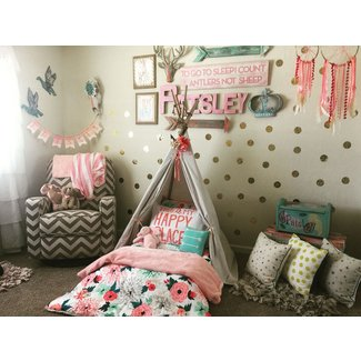 Wild and free toddler room. Tee pee Montessori bed on